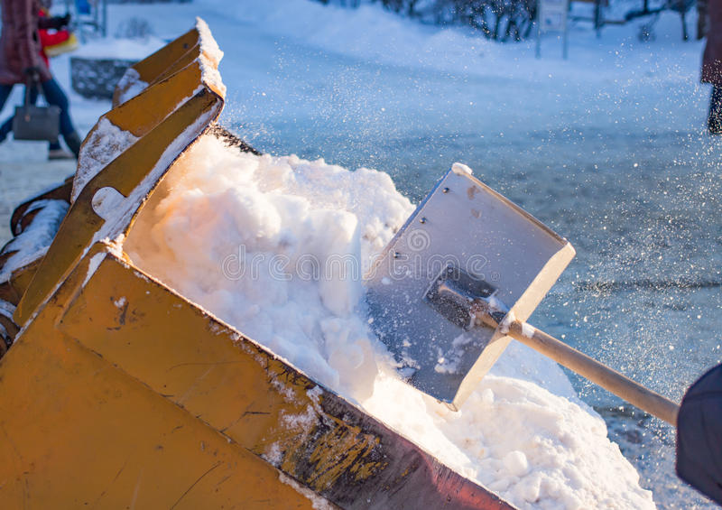 Bucket filled with snow shovel royalty free stock photos