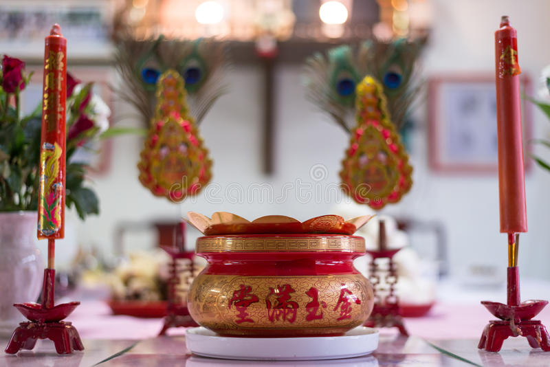 A bucket of incense marked with chinese alphabet represent prosperity. the ritual was made in chinese new year. stock photo