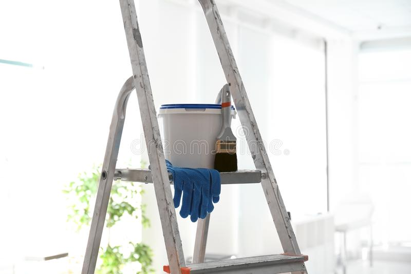 Bucket with paint, brush and gloves royalty free stock images
