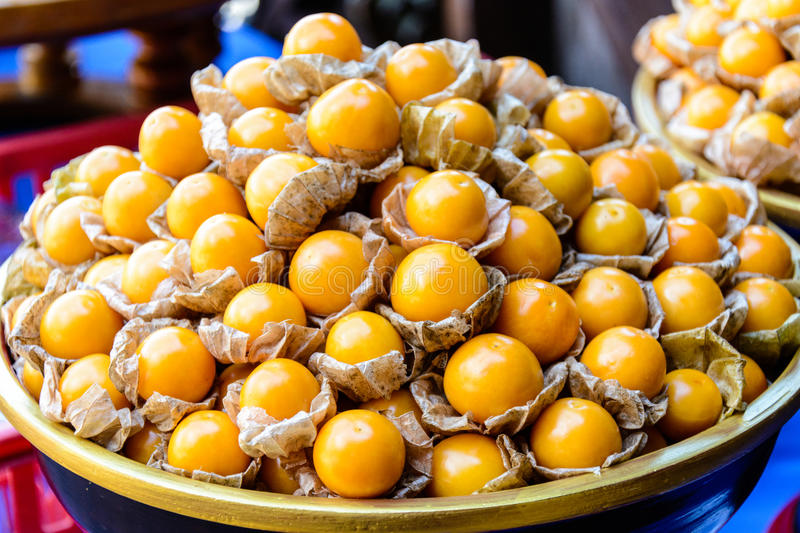 Bucket of raw cape gooseberry. stock images