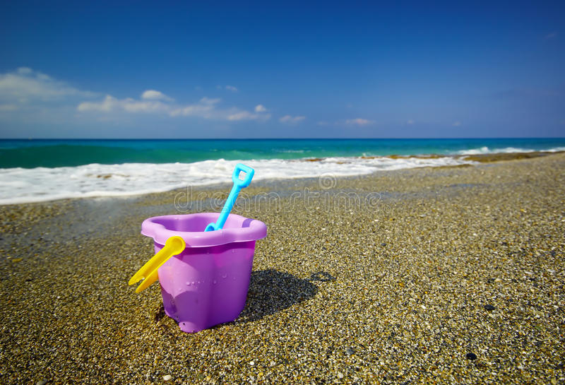 Bucket And Spade On The Beach Sand Stock Images