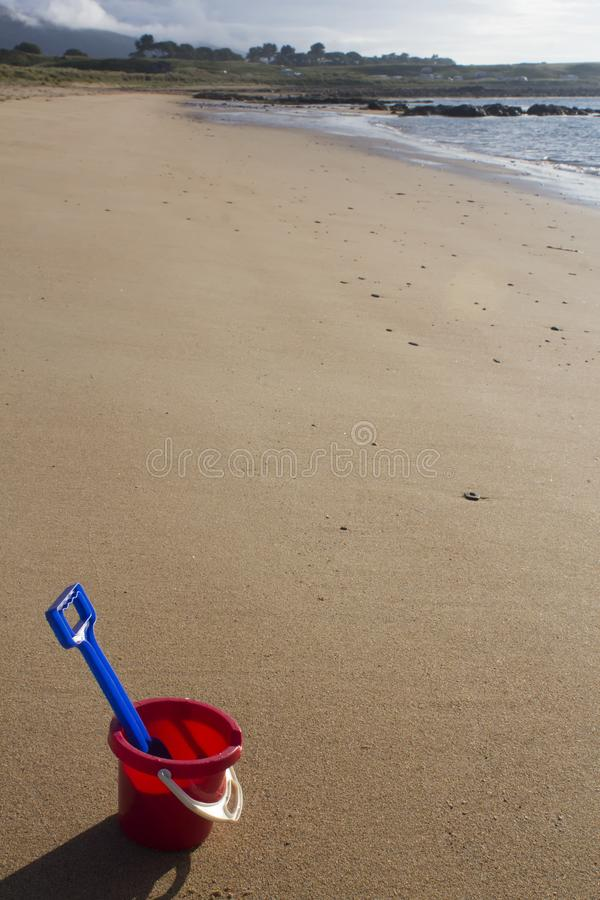 A bucket and spade on a sandy beach in Sutherland, Scotland., royalty free stock photos