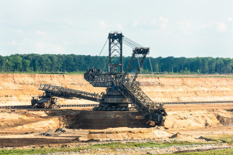 Bucket-wheel excavator digging lignite (brown-coal). One of the world's largest bucket-wheel excavators is digging lignite (brown-coal) in of the world's deepest royalty free stock images
