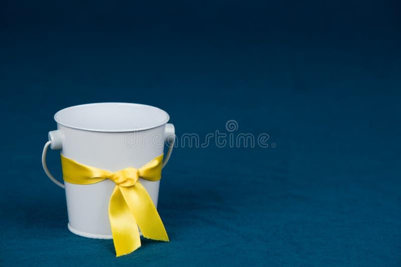 Bucket with Yellow Ribbon