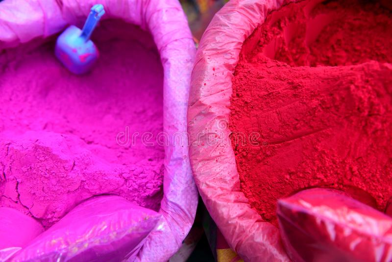 New Delhi, India, buckets of brightly colored pink and red Holi festival powders royalty free stock images