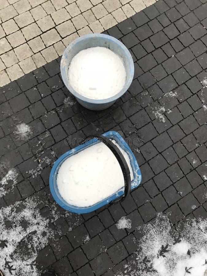 BUCKETS OF SALT TO KEEP SIDEWALKS DRY IN WINTER stock images