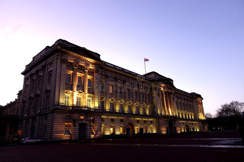 Buckingham Palace. Close view of Buckingham Palace photographed at twilight with the façade illuminated. Built in 1703 by the Duke of Buckingham, it is now stock photography
