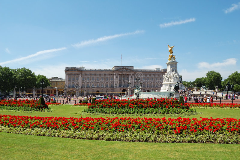 Buckingham Palace and gardens. In a clear day royalty free stock image