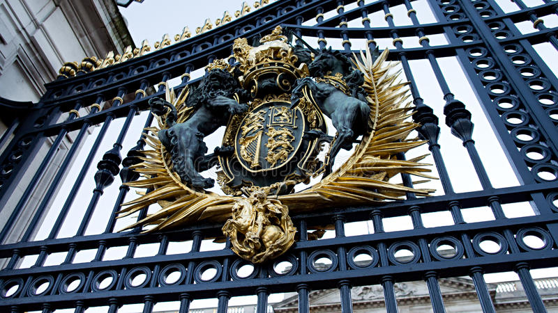 Buckingham Palace gate. A close up view of the Buckingham Palace gate emblem. The emblem symbolises the arms of the United Kingdom and combines the arms of royalty free stock photos