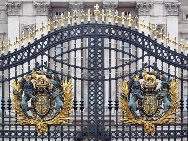 Buckingham Palace Gate. The front gate at Buckingham Palace in London,England decorated with gold embellished Royal Coat of Arms of the United Kingdom royalty free stock image