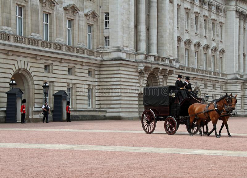 Buckingham Palace and Horse and Buggy royalty free stock photo