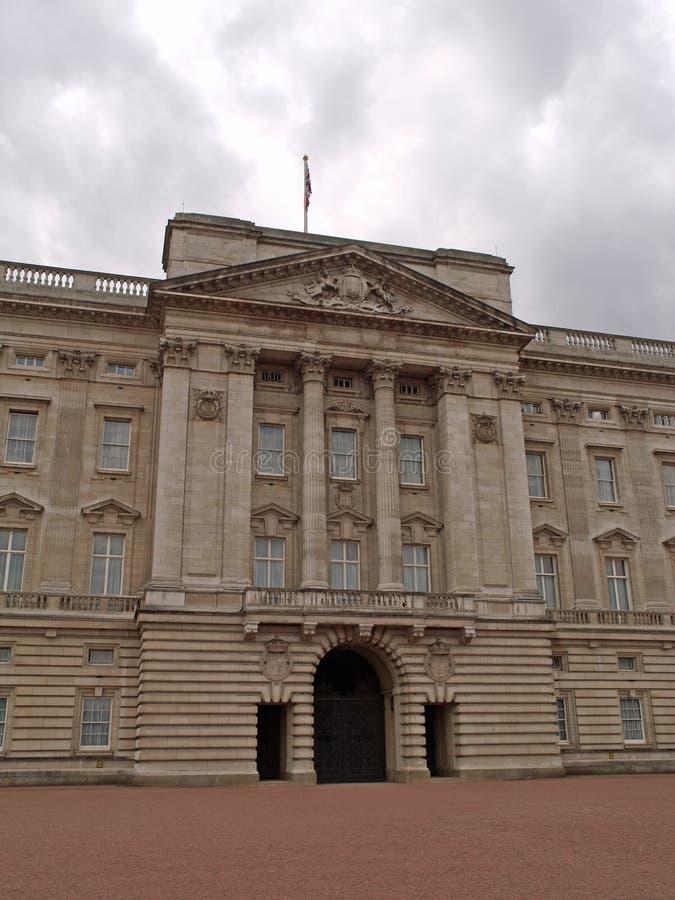 Buckingham Palace, London. Queen Elizabeth the II's residence in London Buckingham Palace with tourists royalty free stock photo