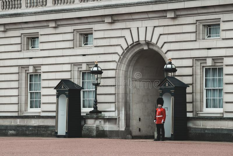 Buckingham Palace Queens guards standing strong. Buckingham Palace Queens guards protecting the Queen ensuring safety with the rifle stock images