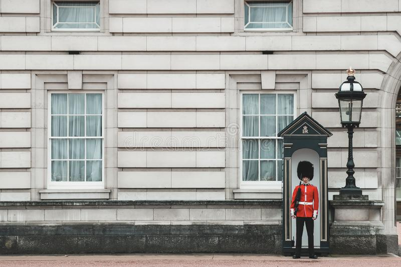 Buckingham Palace Queens guards. Standing tall and strong protecting the queen stock images