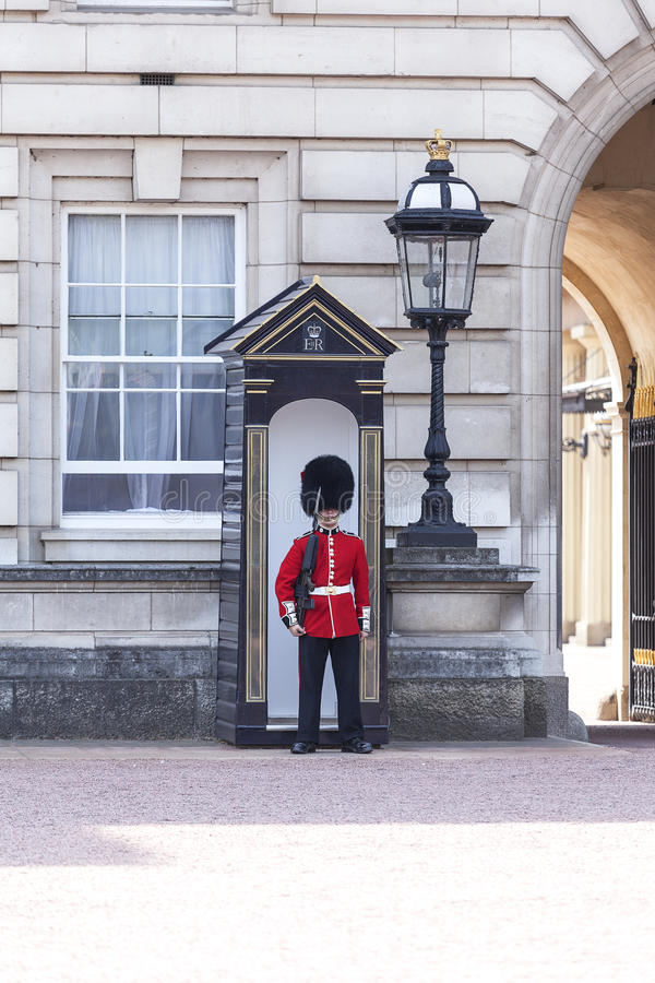 Buckingham Palace with Royal guards on the guard, London, United Kingdom. LONDON, UNITED KINGDOM - JUNE 21, 2017 : Buckingham Palace with Royal guards on the stock photo