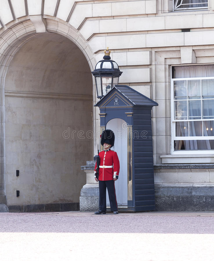 Buckingham Palace with Royal guards on the guard, London,United Kingdom. LONDON, UNITED KINGDOM - JUNE 21, 2017 : Buckingham Palace with Royal guards on the stock image