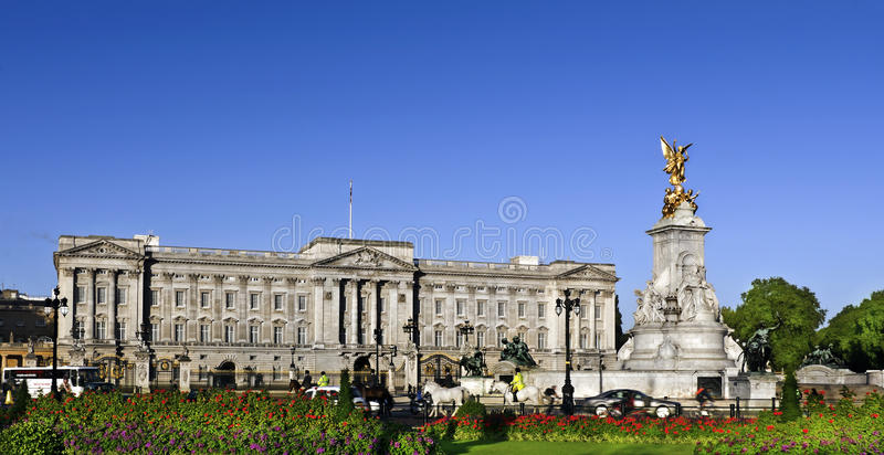 Buckingham Palace in summer. Victoria Memorial and Buckingham Palace London, home to the Queen of England. Clear deep blue summer sky royalty free stock image