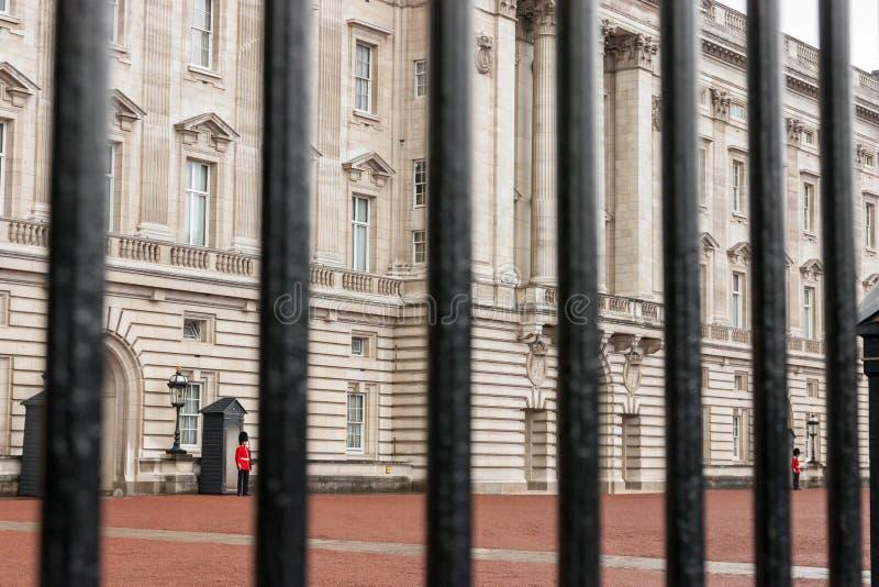 Buckingham palace. View of Buckingham Palace behind the fence royalty free stock image