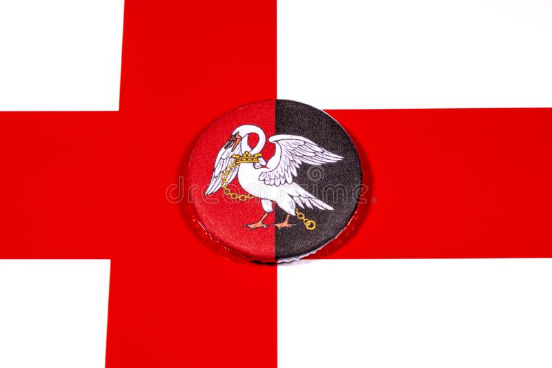 Buckinghamshire in England. A badge portraying the flag of the English county of Buckinghamshire pictured over the England flag royalty free stock photos