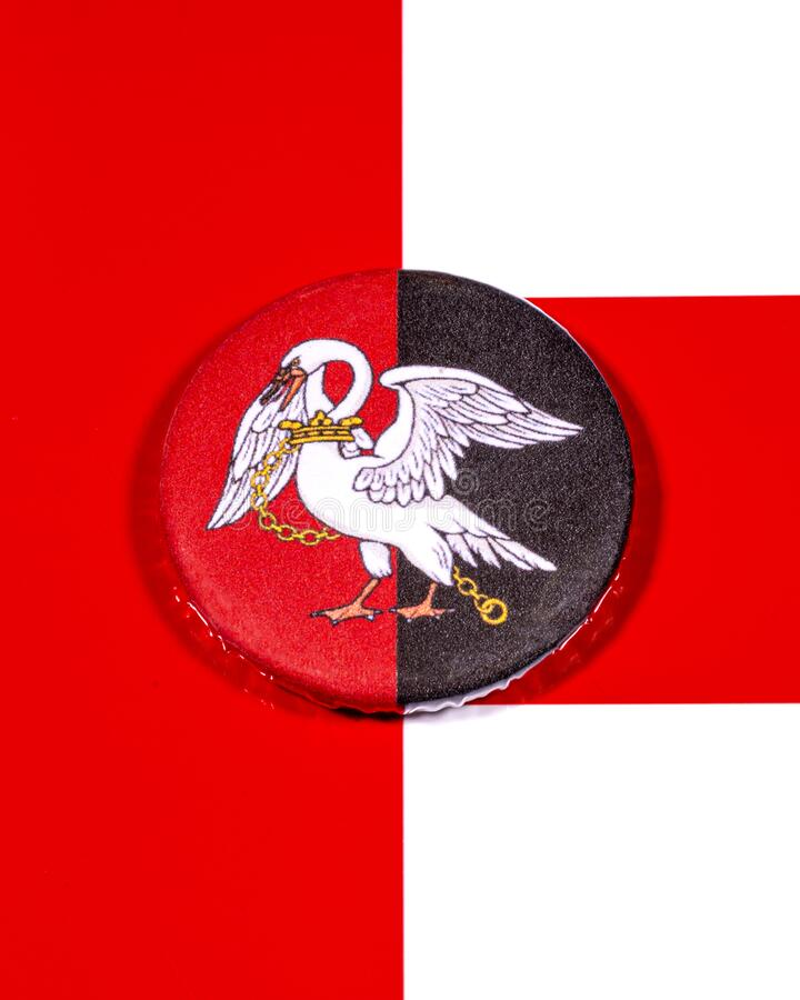 Buckinghamshire in England. A badge portraying the flag of the English county of Buckinghamshire pictured over the England flag stock photos