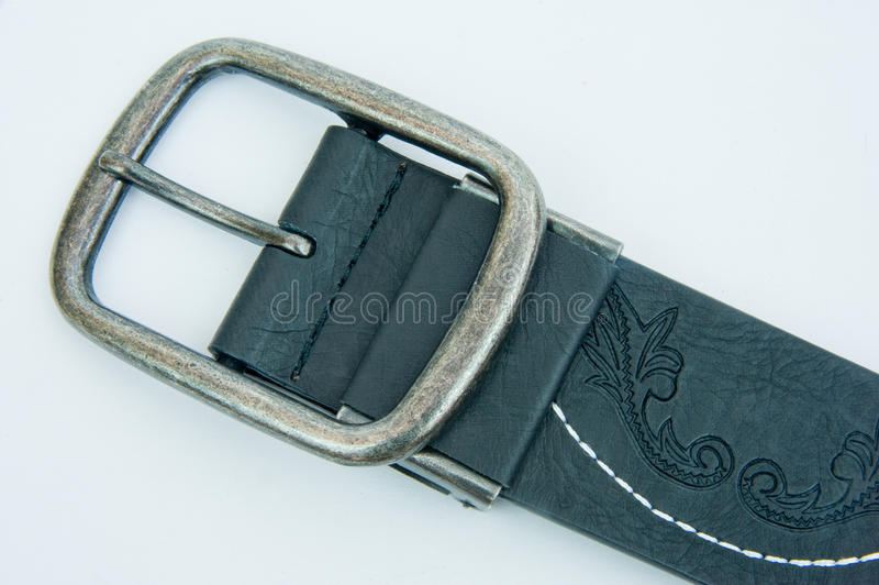 Buckle on leather belt. stock photo