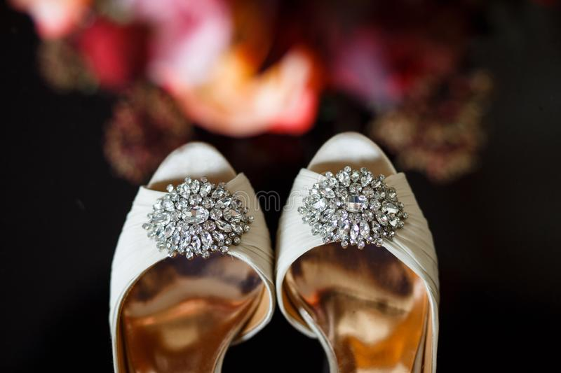 Buckles with crystals on wedding shoes royalty free stock photos