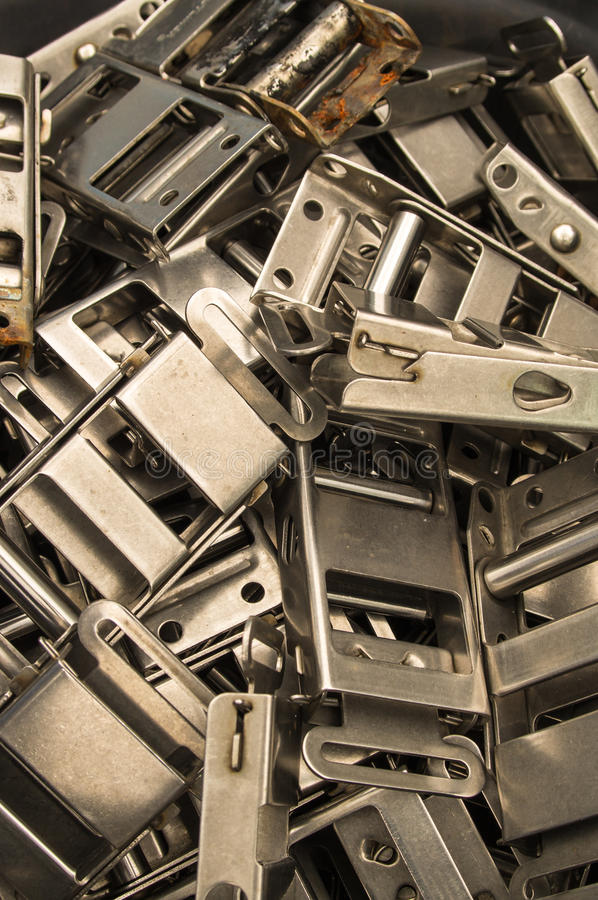 Buckles. A pile of discarded metal strap buckles stock images