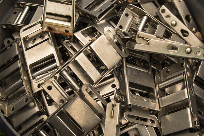 Buckles. A pile of discarded metal strap buckles royalty free stock image
