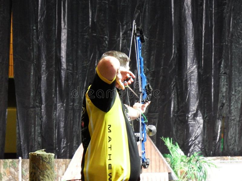 Buckmasters Arena Competing Archer Back View at Buckmasters Archery Competition 8-17-19 in Montgomery, Alabama. Buckmasters Arena Competing Archer Back View at royalty free stock image