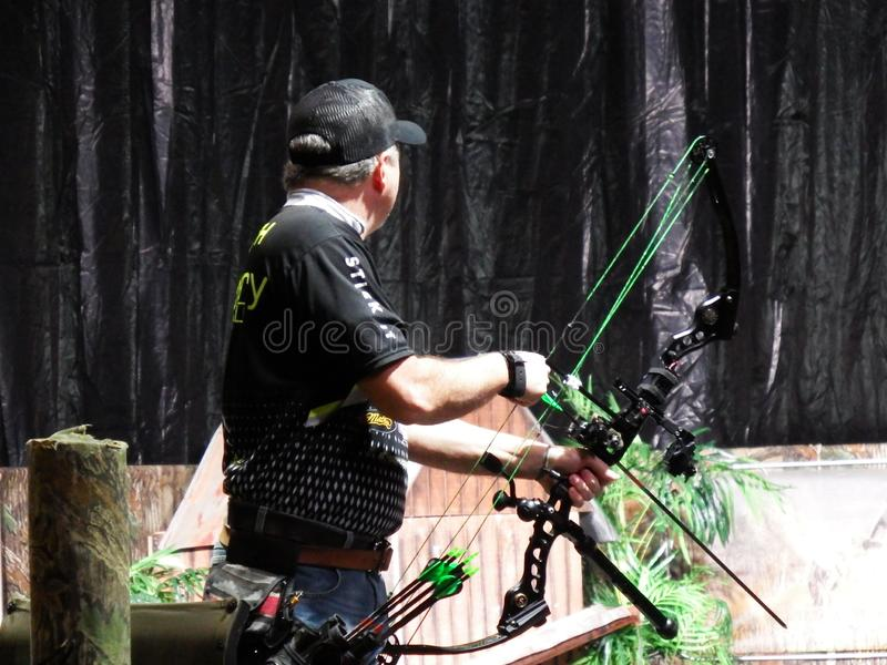 Buckmasters Arena Competing Archer Side View at Buckmasters Archery Competition 8-17-19 in Montgomery, Alabama. Buckmasters Arena Competing Archer Side View at royalty free stock photo