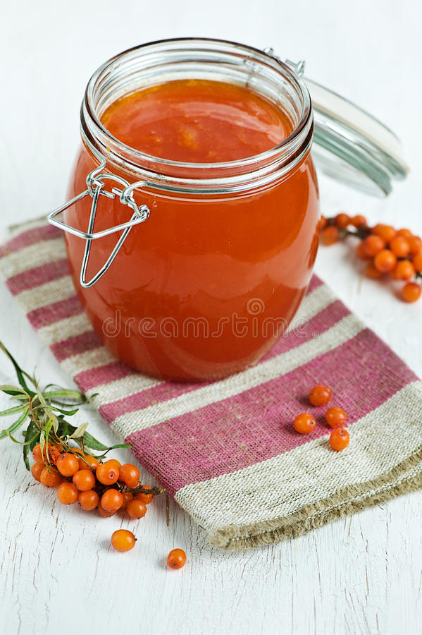 Buckthorn jam. Sea-buckthorn jam in the glass jar stock images