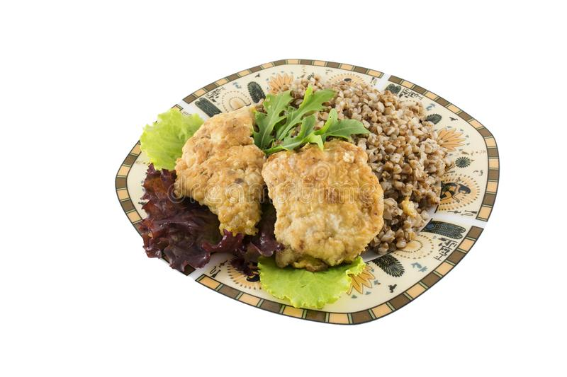 Buckweat with chicken chops amd green salad isolated royalty free stock photos