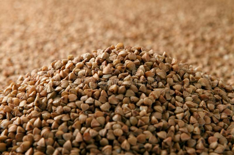 Close-up heap of raw buckwheat royalty free stock images