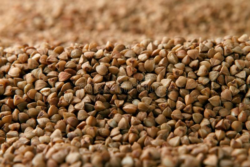 Close-up heap of buckwheat royalty free stock photo