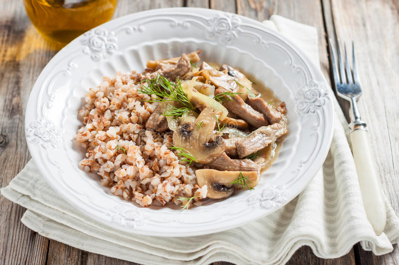 Buckwheat with beef and mushrooms stock photo
