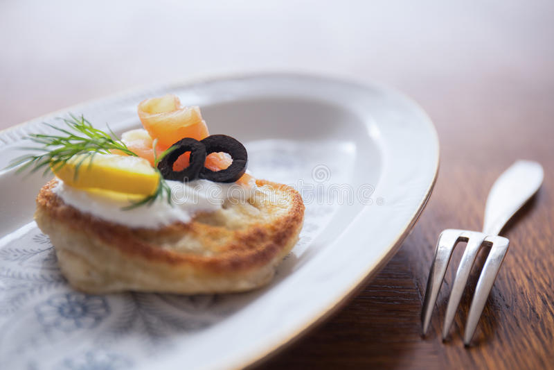 Buckwheat blini with smoked salmon stock photo