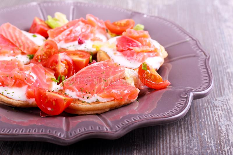 Buckwheat blinis with smoked trout royalty free stock images