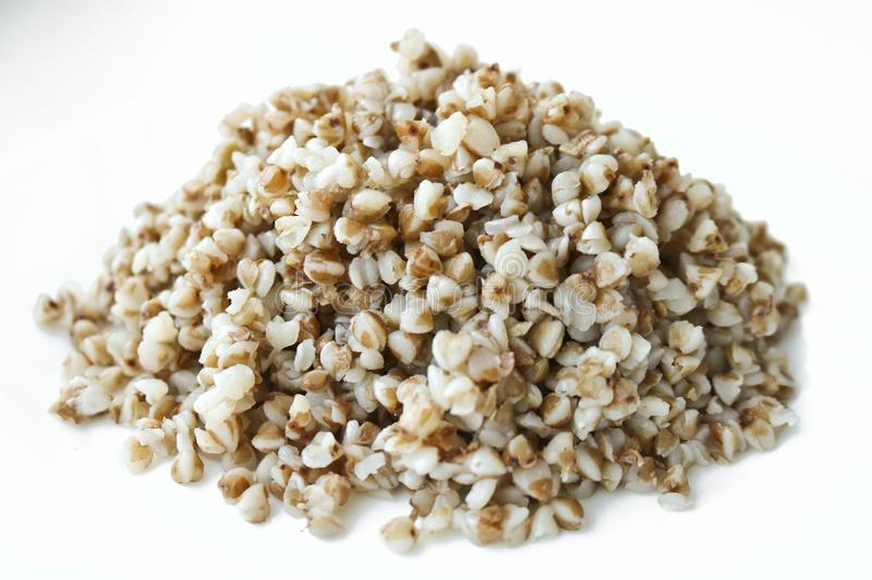Buckwheat. Boiled buckwheat grains on plate. Concept food background stock images