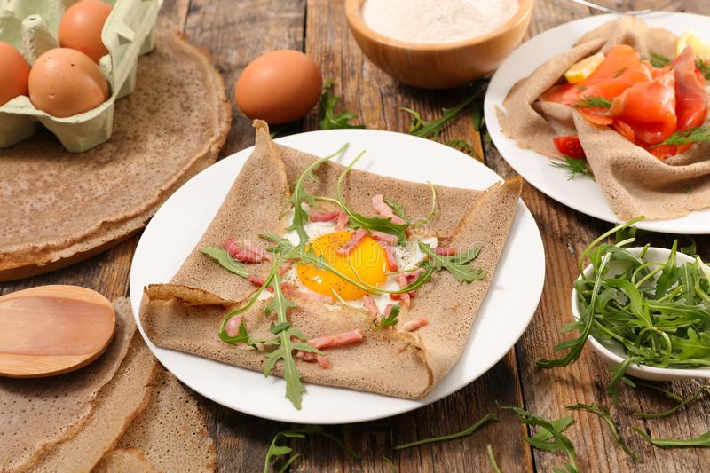 Buckwheat crepe with egg. And salad royalty free stock photography
