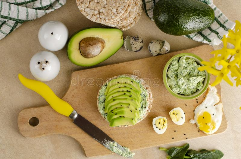 Buckwheat crispbread with cottage cheese, spinach and avocado. Healthy food and ketogenic diet concept stock photos