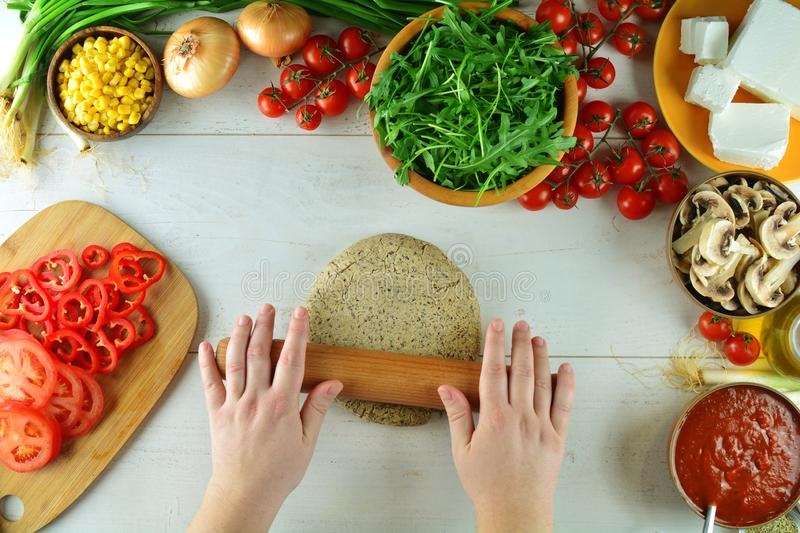 Buckwheat Crust Pizza with Tomato Sauce, Mushrooms, and Sliced Peppers An entire preparation process with final dish. royalty free stock images