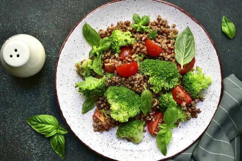 Buckwheat detox salad with broccoli and tomato.Top view with cop stock photo