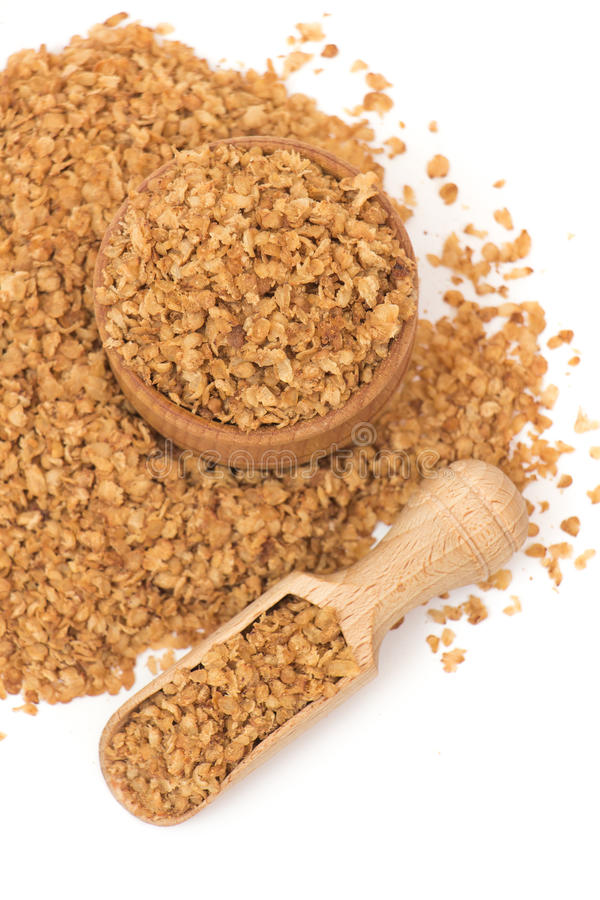 Buckwheat flakes. In a wooden pot on a white background stock image
