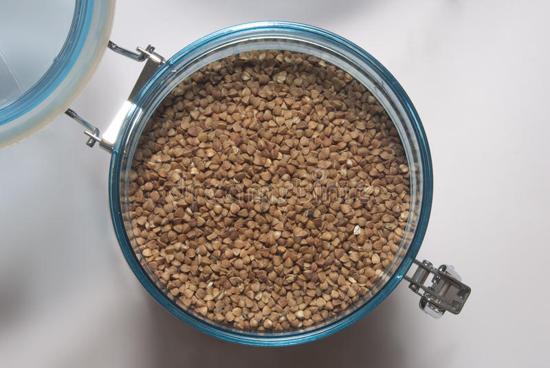 Buckwheat in food container stock images