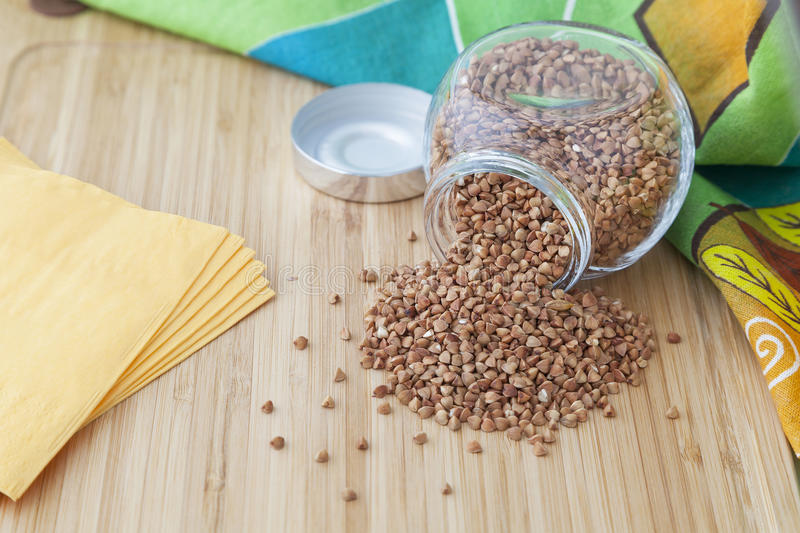Buckwheat grains in a glass stock image