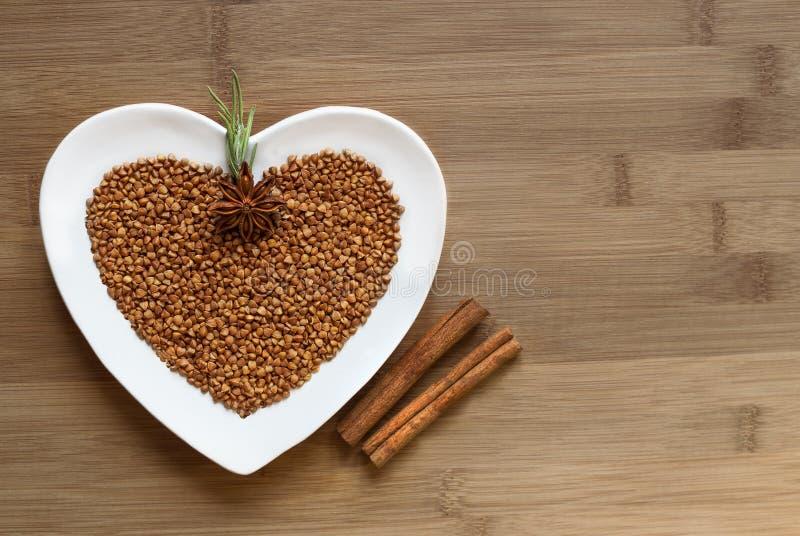 Buckwheat On A Heart Shaped Plate Stock Photo