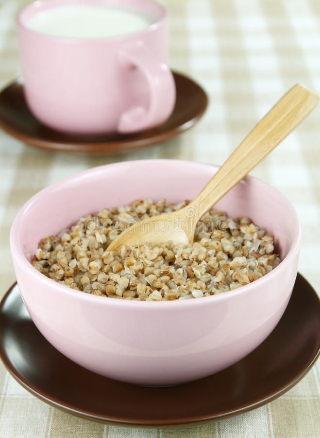 Buckwheat and milk in a cup royalty free stock photos