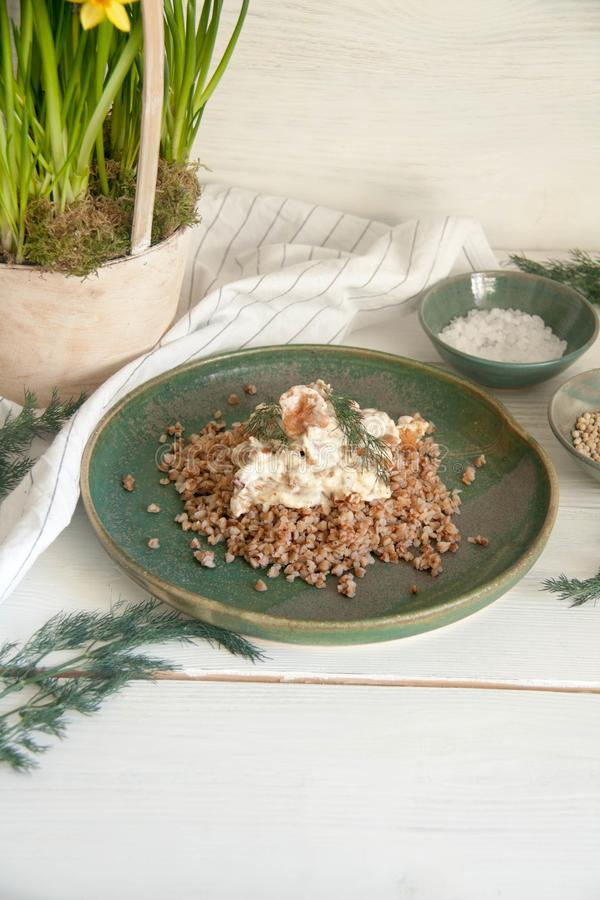 Buckwheat with mushrooms in sour cream sauce. Perfect cozy and delicious dinner: Buckwheat with mushrooms in sour cream sauce stock photo