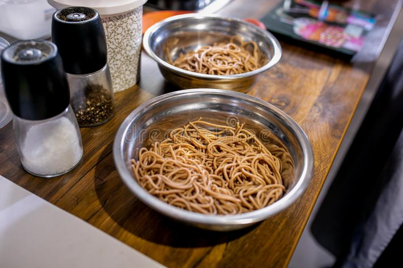 Buckwheat noodles in bowls. Master class in the kitchen. The process of cooking. Step by step. Tutorial. Close-up stock images