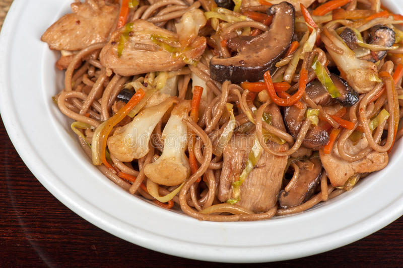 Buckwheat noodles with chicken stock images